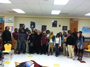 Jean McGarry, surrounded by Meredith Maddox's English class at Paul Laurence Dunbar High School in Baltimore. Photo by Nate Brown.