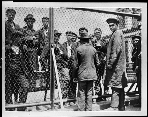 Immigrants in 1902 in a detention pen on the roof of the main building. Detention meant that something was wrong and could lead to days or months in unsanitary and crowded quarters, as well as deportation.  Courtesy of Library of Congress, LC-USZ62-116223.
